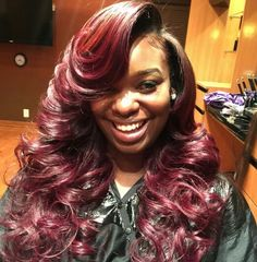 .Sew in weave hairstyle with color