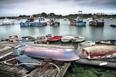 Small harbour and colourful fishing boats, Lymington, Hampshire, England, UK