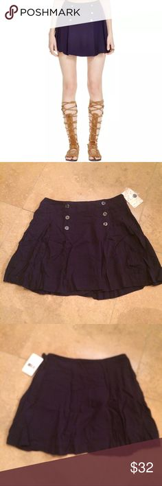 Free People Lovers Lane Pleat Button Skater Skirt Reasonable offers welcomed!  No trades.  A cute navy blue lovers lane pleated Button detail skater mini skirt by Free People. Lined. Manufacturer: Free People Retail: $68.00 Condition: New with tags Size: 2 Inquire for measurements! Material: 100% Rayon Free People Skirts Mini