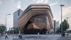Images have emerged of a new arts and culture centre by Foster Partners and Heatherwick Studio, which forms part of a new financial quarter in Shanghai