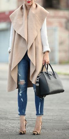 Must-have item for the fall: a longline vest. We love this camel vest paired with a long sleeve tee shirt, ripped jeans, heels, and a black bag.