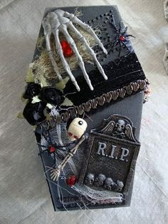 Coffin with book inside.