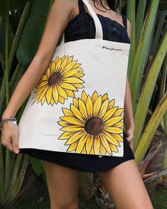 The Botanical Collection- Sunflower 🌻 Avalaible on etsy Unique hand painted totes Tods Bag, Tote Bags Handmade, Diy Tote Bag, Printed Tote Bags, Canvas Tote Bags, Painted Canvas Bags, T Shirt Designs, Jute Bags, Fabric Bags