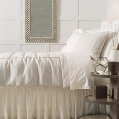 Take a tailored approach to bed dressing with this neutral linen chambray duvet cover. Featuring a single ivory pleat, this comfortable duvet is a classic piece with timeless appeal. Crafted to be an exact match to our Hampton Ticking Linen Natural duvet, shams, and decorative pillows. • 100% linen chambray. • Knife edge. • Hidden button closure.