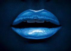 Azure blue lips, on darker blue background. from Tumblr.