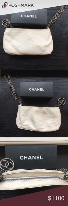 White leather Chanel shoulder or wristlet bag White leather Chanel bag. Can be used over the shoulder or as a wristlet. In good used condition. Some makeup marks in the interior lining and slight mark near the zipper as pictured. Adorable bag. CHANEL Bags