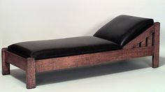 American Mission, oak chaise with black leather upholstery.