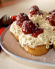 """User Jessicakes serves up a spin on a classic Italian-American dinner: Vanilla cupcakes with vanilla """"spaghetti"""" icing, fresh strawberry """"marinara"""" sauce, and chocolate hazelnut """"meatballs."""" It's all dusted with shredded white-chocolate """"Parmesan cheese."""""""
