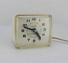 Pretty sure I had this exact alarm clock. The face glowed orange at night.