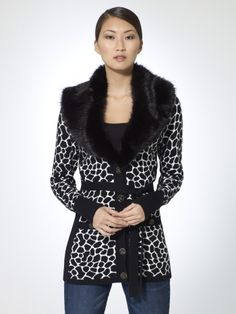 Black and white animal print cardigan with button front. Black ribbed back. Detachable faux fur collar. Self belt. Printed front/sleeve: 60% rayon, 40% nylonBack/side: 56% nylon, 44% rayonFaux fur collar: 88% modacrylic, 12% polyesterInner collar: 100% polyesterImportHand wash