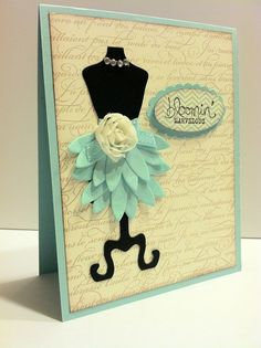 """Stampin Sunshine 2 Pool Party flowers were cut in half to make a pretty skirt.  The Pool Party ribbon and 5/8"""" Flower trim add a special touch to the waist of the skirt. Card Details Stamp Sets:  En Francais, Bloomin' Marvelous, Oh, Hello! Paper: Pool Party, Basic Black, Very Vanilla Ink:  Crumb Cake, Staz'On Black Tools and Accessories:  All Dressed Up framelits, Large Oval, Scallop Oval, Designer Rhinestones, Sycamore Street Pool Party Ribbon, Pop-Up Posies Designer Kit, 5/8"""" Flower Trim."""