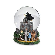 A nostalgic collection of Wizard of Oz characters including Dorothy, the Wicked Witch of the West, Glinda the Good Witch, the ruby slippers, the Witch's crystal ball and Toto, too. Description from shopheadlines.com. I searched for this on bing.com/images