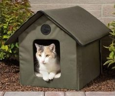 Heated or Unheated Outdoor Cat Shelter. Provide your Outdoor Cat with some protection from the elements this winter with this Heated Outdoor Cat House. This Kitty Condo is made of 600 Denier Nylon that has a vinyl backing (which makes it Water Resistant) to keep your pets dry and comfy. There are two exits on this Pet Pod that gives your poody tat a means of escape from predators.