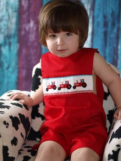 Boys smocked tractor shortall made in 100% cotton. Your little men is going to look absolutely adorable in this gorgeous outfit. *Shirt not included*