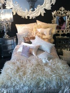 Bedroom- Black wall, behind bed, other walls, a rich, beige. Decorate with beige on black walls, black on beige walls. Glitter pillows! Shades of gold, silver, shimmery lavender, and shades of beiges