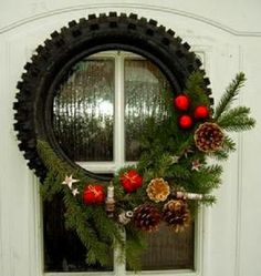 Christmas wreath with dirt bike tire and spark plugs