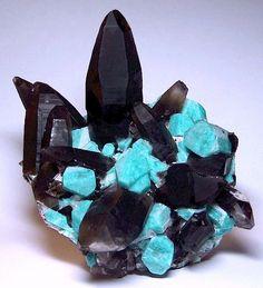 Smoky quartz crystals with amazonite. Teller County, Colorado