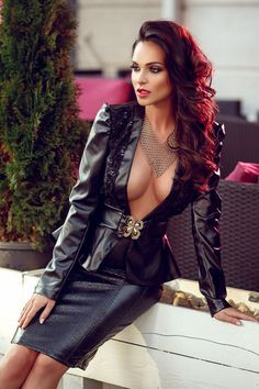 Stunning busty brunette in a plunging leather jacket