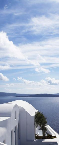 Cycladic style architecture and stunning blue sea views at the Katikies Hotel in Santorini
