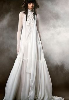 CLÉMENCE is a light ivory hand draped French tulle A-line off the shoulder wedding gown with draped sleeve accents by Vera Wang.
