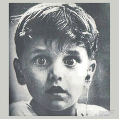 Harold Whittles hears for the first time ever after a doctor places an earpiece in his left ear.This photo was taken by photographer Jack Bradley, and depicts the exact moment when this boy,hears for the very first time ever.
