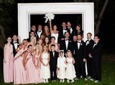 pink and white eco-friendly wedding party with a DIY photobooth backdrop picture