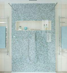 Blue mosaic tiled modern shower with rainfall shower head