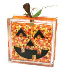 glass block filled with candy corn & jack-o-lantern decorations ~ great 'guess the number' item, teacher gift or decoration ~ halloween diy Halloween Boo, Holidays Halloween, Halloween Treats, Halloween Decorations, Lantern Decorations, Halloween 2019, Pumpkin Decorations, Halloween Pumpkins, Pumpkin Crafts