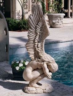 Add Powerful Beauty with this Crouching Angel Statue