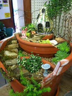 Broken pot fairy garden with succulents.  Designed by Kristin Middleton