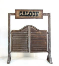 The inspiration for our entrance to the outdoor area being decorated: double, swinging saloon doors.