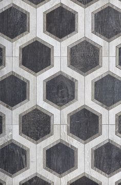 From Walker Zanger, Sterling Row Hexagon, a wood-finish ceramic tile.