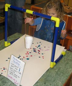 pendulum painting with soccer net frame
