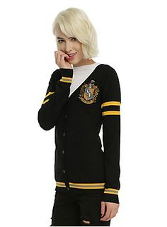 """<p>""""Where they are just and loyal, those patient Hufflepuffs are true, and unafraid of toil."""" - The Sorting Hat</p>  <p>As you're walking through the halls at school, pretend you're a student at Hogwarts while wearing this cardigan from <i>Harry Potter</i>. It's black with an embroidered Hufflepuff house crest, yellow stripes and front botton-up closure. Dedicated, hard working and kind... yeah, you belong in Hufflepuff. </p>  <ul> <li>71% rayon; 29% polyester</li> <li>Wash..."""