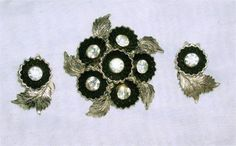 Vintage Black  Rhinestone  Flower Brooch Pin  and Clip On Earrings  Pat. No. 2733491   Brooch has raised center  and measures approx. 1 3/4  Earrings measure approx. 1   Gorgeous!   Excellent Condition