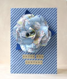 """enjoy the journey by L. Bassen, via Flickr. """"Maptastic"""" paper flower using an old atlas page. Rose template is linked"""