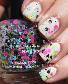 Scribble Me This is a multi colored glitter topper with hex, star and triangle glitter in a clear base.