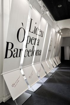 The exhibition is part of the institutional events to commemorate the tenth anniversary of the reconstruction of the Gran Teatre del Liceu. The exhibition is Signage Display, Event Signage, Wayfinding Signage, Signage Design, Stand Design, Display Design, Booth Design, Design Design, Environmental Graphic Design