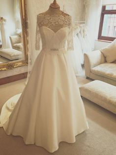 Creating different looks for each bride is a reality at Huw Rees Brides were you can dress up this simple plain dress to create your very own design.