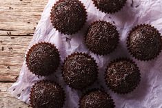 Serve these delectable chocolate treats in miniature cupcake wrappers for easy servings and cleanup. The chocolate snowballs are a quick and ultra chocolaty treat that will make you look like the pastry chef of your neighborhood. Chocolate Snowballs, Chocolate Sprinkles, Chocolate Treats, Snowball Cookies, Cupcake Wrappers, How To Make Cookies, Mini Desserts, Bake Sale, Vegetarian Chocolate