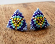 Items similar to Beaded Triangle Stud Earrings in Blue Yellow and Gold. Modern geometric design custom gift girl small tiny triangle stud earrings teen on Etsy Seed Bead Earrings, Seed Beads, Stud Earrings, Candy Jewelry, Beaded Jewelry, Jewellery, Peyote Patterns, Earrings, Tutorials