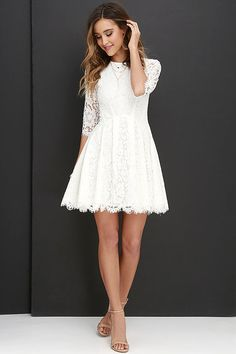 Romance and whimsy will always accompany you and the Love Letter Ivory Lace Dress! Stunning eyelash lace covers a rounded neckline and princess-seamed bodice, finished with sheer three-quarter sleeves. Curved seams top the pleated skater skirt. Hidden back zipper with clasp.