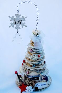 Paper Christmas tree. It doesn't look like directions are given on how to make it but it should be pretty easy.