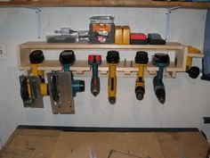 "organizing tools in the garage (we don't have a garage but we have ""shop room"" that is full of tools etc. hubby could make this for sure.. )"