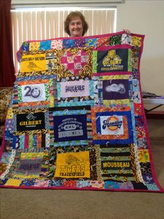 T-shirt quilt! Totally want to try this. Now I know what to do with all of those event & school t-shirts I have!