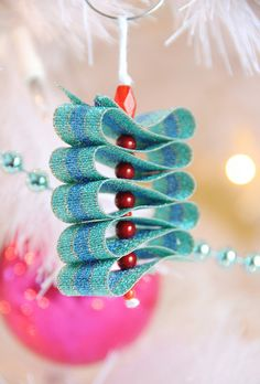 Love this idea -- use green ribbon and red beads and make the shape of a tree for a cute Christmas ornament.