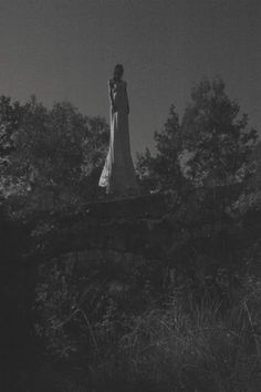 Woman black white spooky ethereal solitary goth mysterious forest nature ruins haunting atmospheric by Florian Gerbaud