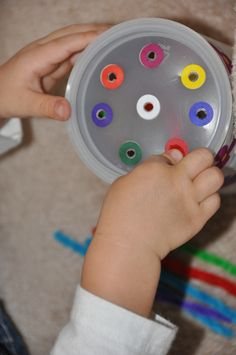 Great idea to use leftover coffee cans and pipe cleaners to make a homemade toy. #earlyed #earlychildhood