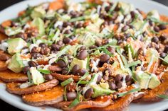 Sweet Potato Nachos1 bag frozen alexia sweet potato fries1 cup black beans1 cup frozen cornHandful grape tomatoes 2 avocados McCormick taco seasoningCheddar cheese (shredded) Sprinkle taco seasoning over potatoes before baking. Bake according to package directions. Layer with black beans, corns, spr...