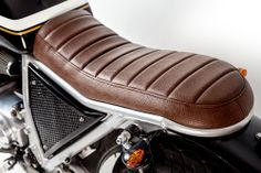 Nice Brown cafe racer seat. I like the metal grid covering the battery, too.